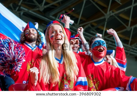 Happy fans in stadium - stock photo
