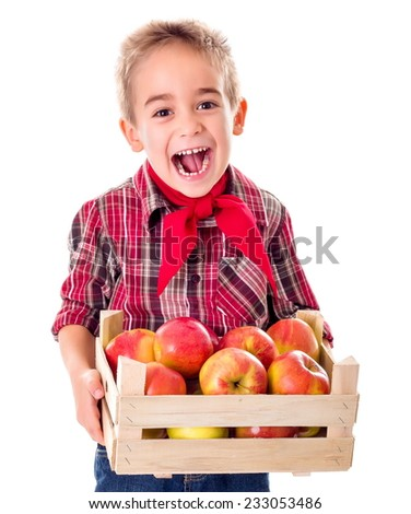 Happy farmer boy holding big crate full of ripe apples - stock photo