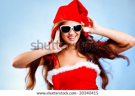 Happy fashion Santa helper with long hair on blue background - stock photo