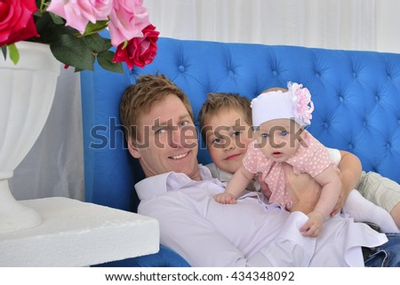 Happy father and children - stock photo