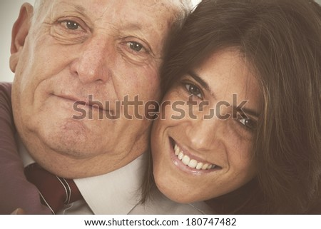 happy father and daughter giving a tenderness hug - stock photo