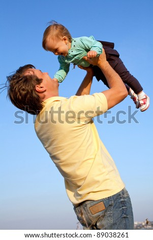 happy father and daughter playing on sky background - stock photo