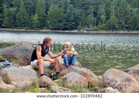 Happy father and his adorable daughter having fun outdoor hiking