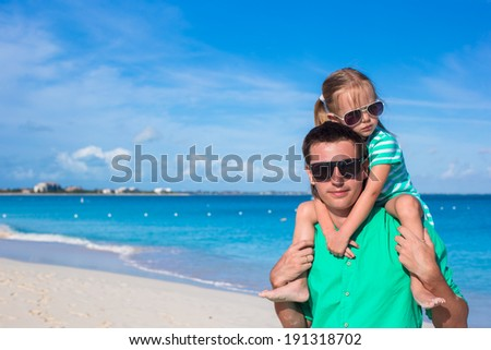 Happy father and his adorable little daughter together at the beach - stock photo