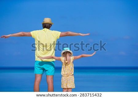 Happy father and his adorable little daughter together outdoor - stock photo