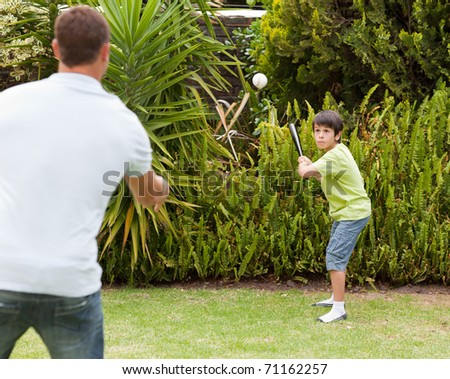 Happy father and his son playing baseball - stock photo