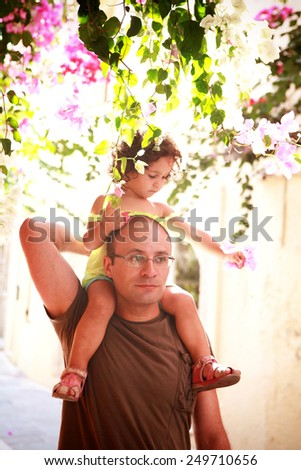 Happy father and his sweet little daughter in the park - stock photo