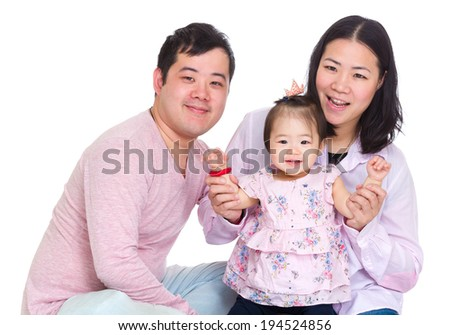 Happy father and mother holding baby daughter hand