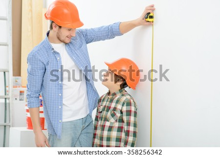 Happy father and son doing renovation
