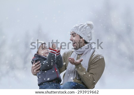 Happy father and son enjoying winter - stock photo
