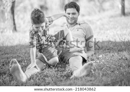 happy father and son having fun in park