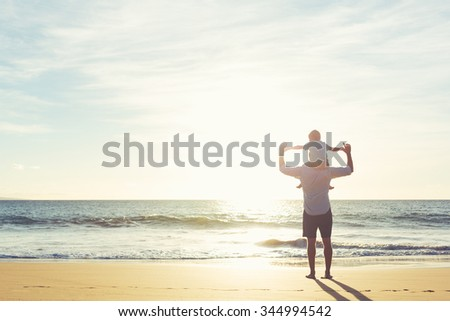 Happy Father and Son Having Fun Playing on the Beach at Sunset. Fatherhood Family Concept - stock photo