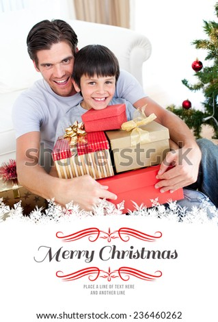 Happy father and son holding Christmas presents against border - stock photo