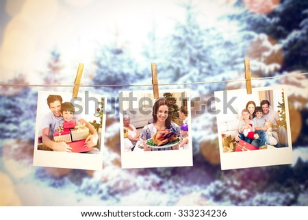 Happy father and son holding Christmas presents against snow covered forest against sky - stock photo