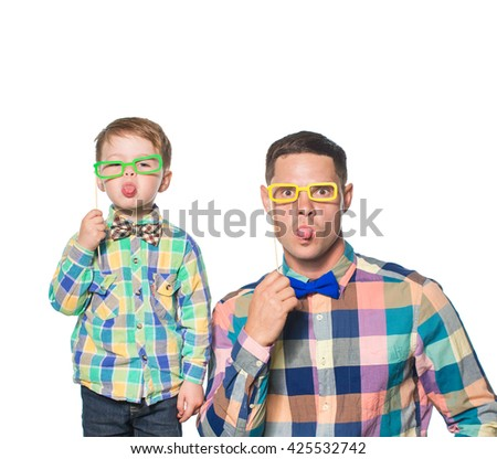 Happy father and son playing with paper glasses isolated on white - stock photo