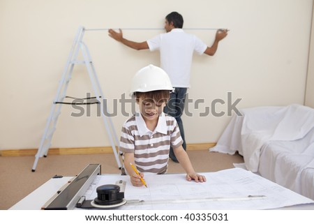Happy father and son refurbishing home together - stock photo