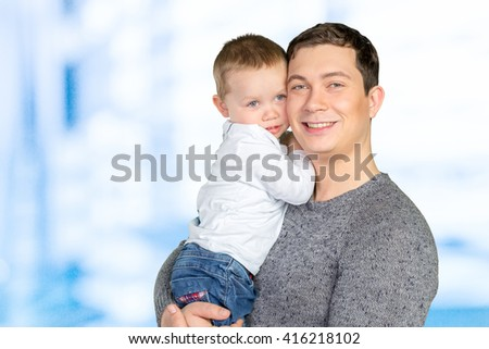 Happy father holding his little son