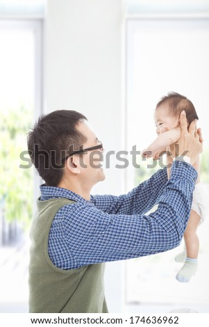 Happy father hug his smiling son at home - stock photo