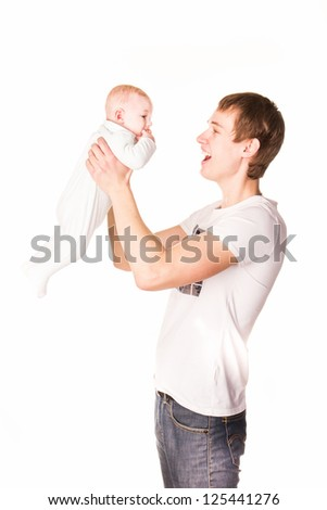 Happy father playing with his baby - stock photo