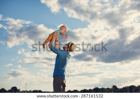 happy father playing with his baby son - stock photo