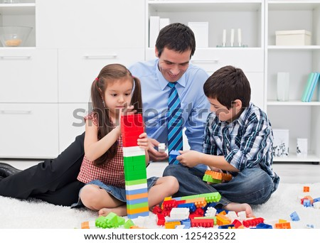 Happy father playing with his children after the working time