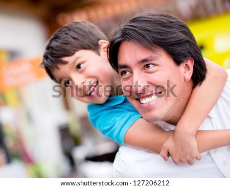 Happy father playing with his son and smiling - stock photo