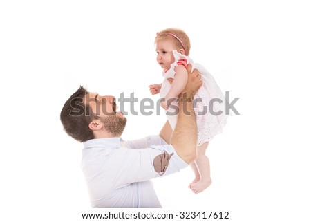 Happy father raise his daughter and having fun isolated on white background - stock photo