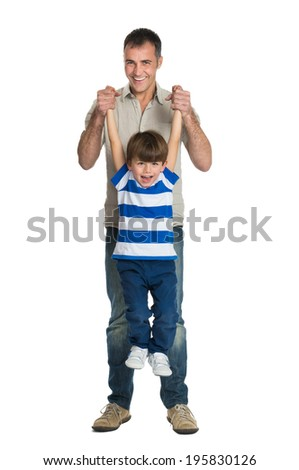 Happy Father Raises The Son Isolated On White Background - stock photo