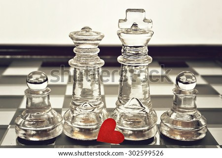Happy Father's Day concept: king, queen and pawns on chess board - stock photo