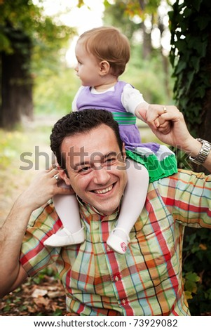 Happy father with his baby daughter outdoors - stock photo