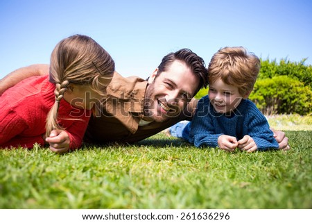 Happy father with his children in the countryside - stock photo