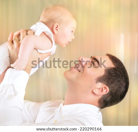 Happy father with newborn daughter on playing at home, cheerful dad lifting up little baby on hands,  love and happiness concept - stock photo