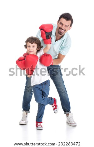 Happy father with son in boxing gloves on a white background - stock photo