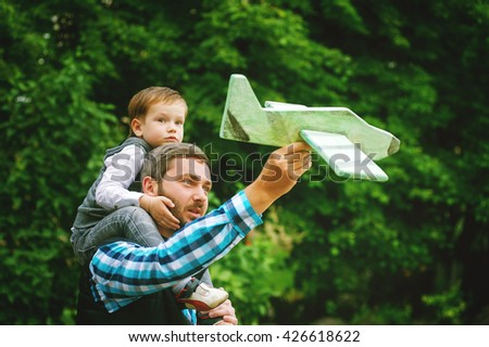 happy father with son playing with toy plane. dream to be a pilot - stock photo