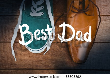 happy fathers day against view of two different shoes