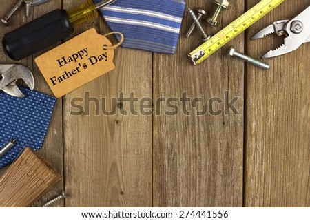 Happy Fathers Day gift tag with corner border of tools and ties on a rustic wood background - stock photo