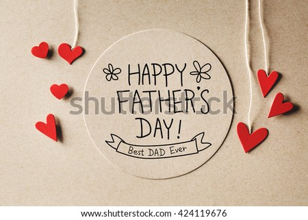 Happy Fathers Day message with handmade small paper hearts - stock photo