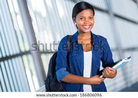 happy female african american college student on campus