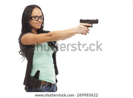 Happy female aiming with handgun against white background - stock photo