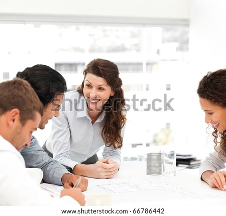Happy female architect with her team during a meeting at the office - stock photo