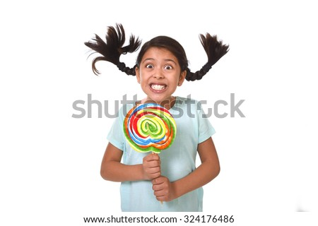 happy female child holding big lollipop candy with pony tails flying in freak crazy funny face expression in sugar addiction and kid love for sweet concept isolated on white background - stock photo