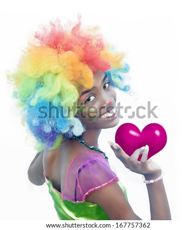 Happy Female Clown Holding a Heart