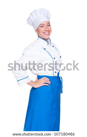 happy female cook in uniform posing against white background - stock photo