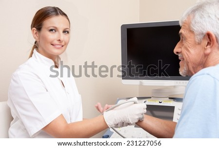 Happy female doctor assisting man patient undergoing wrist echography. Health concept. - stock photo