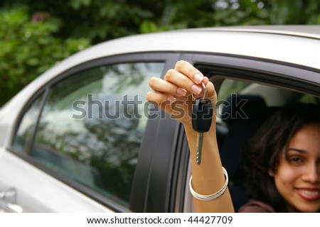 happy female driver showing car keys - stock photo