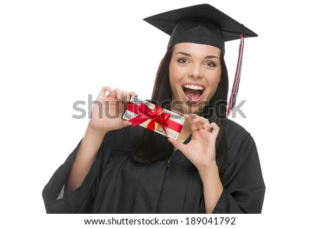 Happy Female Graduate in Cap and Gown Holding Stack of Gift Wrapped Hundred Dollar Bills Isolated on a White Background. - stock photo