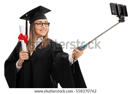 happy female graduate student holding diploma stock photo  happy female graduate student holding a diploma and taking a selfie a stick isolated on