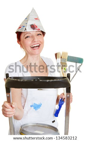 Happy female painter with brushes and ladder and paint buckets - stock photo