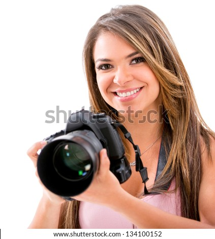 Happy female photographer with a camera - isolated over white - stock photo