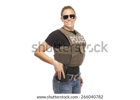 Happy female police officer standing against white background - stock photo
